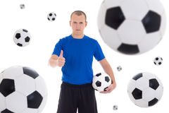Soccer player over white background with flying leather balls Royalty Free Stock Photos