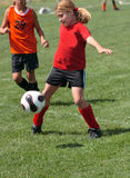 Soccer Player During Play. Girl during play at soccer game Stock Photography