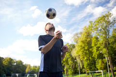 Soccer player playing with ball on field Stock Image