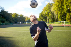 Soccer player playing with ball on field Royalty Free Stock Photo