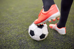 Soccer player playing with ball on football field Royalty Free Stock Photos