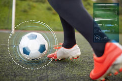 Soccer player playing with ball on football field Stock Image