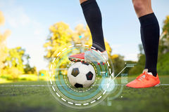 Soccer player playing with ball on football field Stock Photography