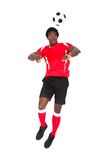 Soccer player playing with football Royalty Free Stock Image