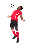 Soccer player playing with football Royalty Free Stock Photography