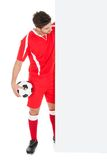 Soccer player pointing at billboard Royalty Free Stock Photo