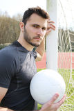 Soccer player posing with ball Stock Images