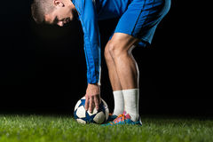 Soccer Player Positions The Ball. On Black Background stock image