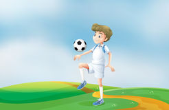 A soccer player practicing Stock Photo