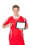 Soccer Player Presenting Tablet Stock Image