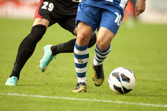 Soccer player protecting a ball stock image
