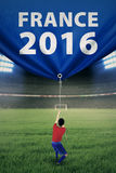 A soccer player pulls banner in stadium Royalty Free Stock Photo