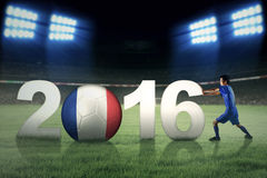 Soccer player pushing number 2016 Stock Image