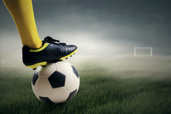 Soccer player ready to kick the ball. Leads to the gate at field Royalty Free Stock Photography