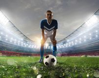 Soccer player ready to kick the soccerball at the stadium during the match. Soccer player ready to kick the soccerball at the illuminated stadium during the royalty free stock photo