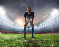Soccer player ready to kick the soccerball at the stadium during the match. Soccer player ready to kick the soccerball at the illuminated stadium during the stock photo