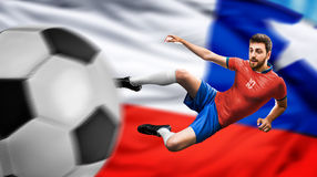 Soccer player on red and blue uniform on chilean flag background Royalty Free Stock Photos