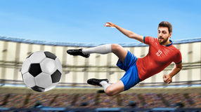 Soccer player on red and blue uniform in the stadium Stock Photo