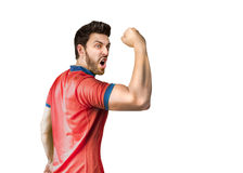 Soccer player on red and blue uniform on white background.  royalty free stock photo