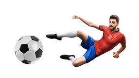 Soccer player on red and blue uniform on white background.  Royalty Free Stock Photography