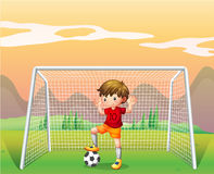 A soccer player in a red shirt Royalty Free Stock Photo
