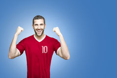 Soccer player on red uniform on blue background Stock Image