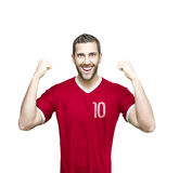 Soccer player on red uniform on white background Royalty Free Stock Image