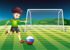A soccer player from Russia kicking the ball Royalty Free Stock Photos