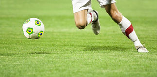 Soccer player's  ball with Brazil flag Royalty Free Stock Image