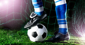 Soccer player's feet Stock Photos