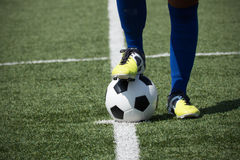 Soccer player's feet on the ball Stock Photography