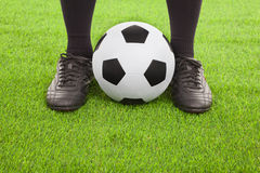 Soccer player's feet with ball Stock Photography