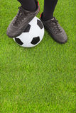 Soccer player's feet and football royalty free stock images
