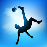 Soccer player scissors kick. Silhouette Soccer player jumping scissor kick Royalty Free Stock Photography