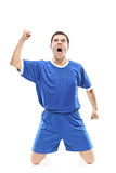 Soccer player screaming Stock Image