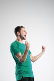 Soccer player in shirt isolated selebrate studio stock image