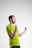 Soccer player in shirt isolated selebrate studio Royalty Free Stock Image