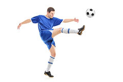 A soccer player shooting a ball Royalty Free Stock Photos