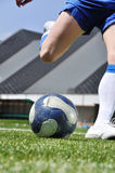 Soccer player shooting ball Royalty Free Stock Photo