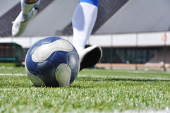 Soccer player shooting ball Stock Photo