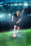 Soccer player shooting ball in the game Royalty Free Stock Images
