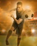 Soccer player shooting a ball Stock Image
