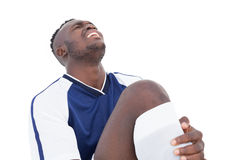 Soccer player shouting in pain Stock Image