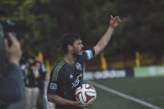 Soccer player on sideline Royalty Free Stock Photo