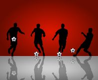 Soccer player silhouettes. Illustration of four silhouetted soccer players on red background, reflecting on gray foreground Stock Images
