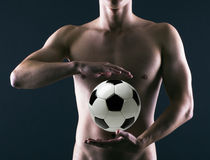 Soccer player with a soccer ball Stock Photography
