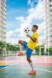 Soccer player. Soccer player showing his skills in the court Stock Images