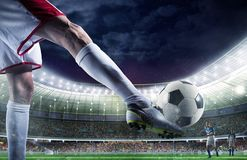Soccer player with soccerball at the stadium ready for the match Stock Photography