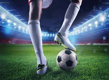 Soccer player with soccerball at the stadium ready for the match Royalty Free Stock Photo