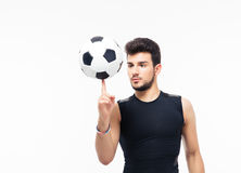 Soccer player spinning ball on his finger Stock Image